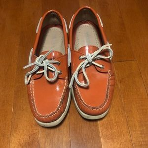 Orange patent leather Sperry Topsider boat shoe